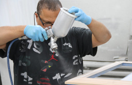 Individual Spray Painting a Frame