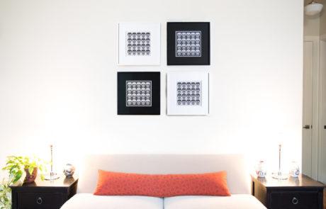 Four Custom Frames on a Wall Over a Sofa