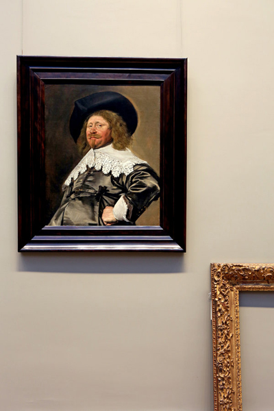 Frans Hal Portrait in New Frame with Empty Old Frame Against Wall