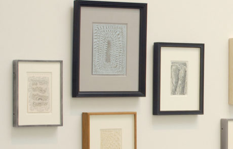 Close Up of Several Artworks with Varying Frames