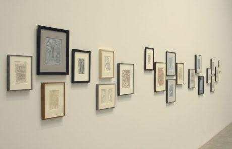 Wall of Artworks in Various Bark Frameworks Frames