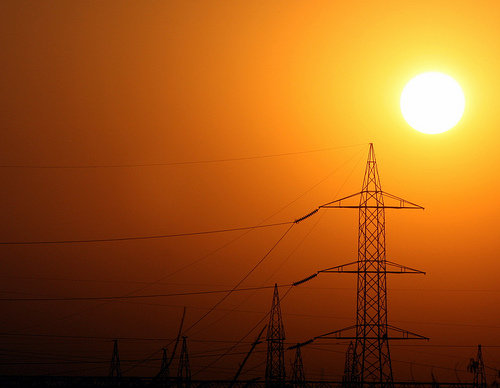 Sun Rising Over Power Lines